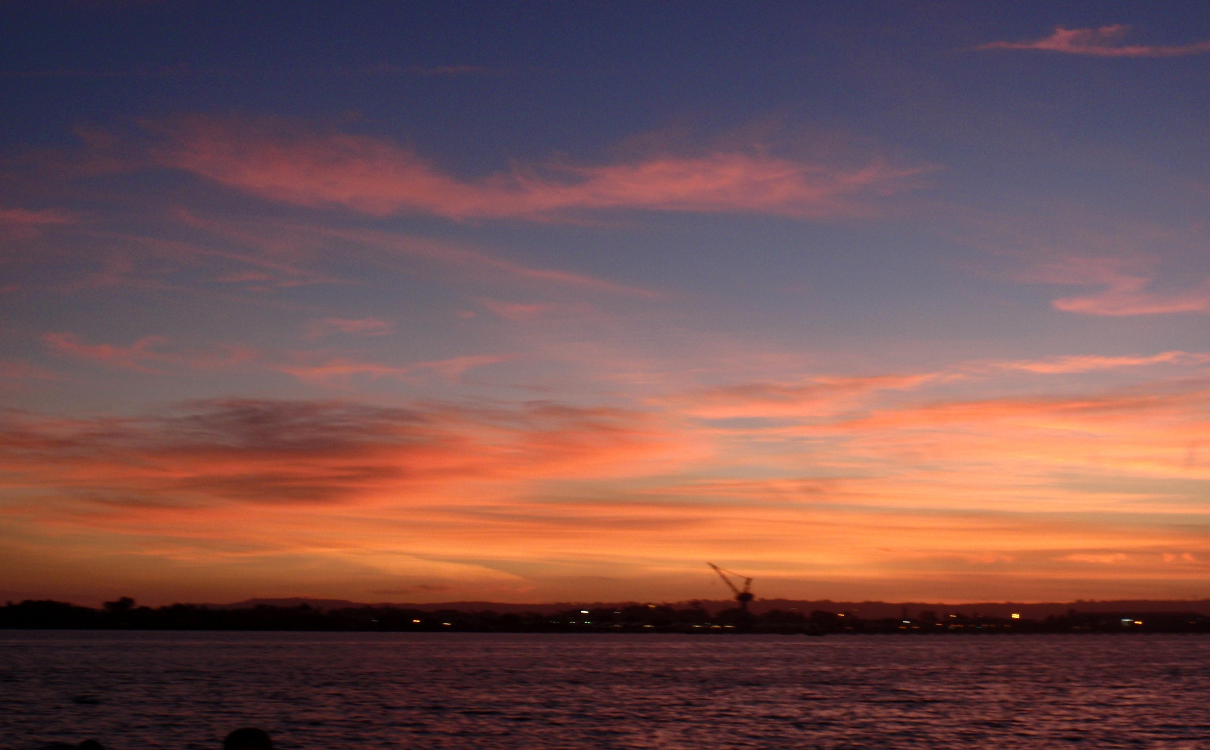San Diego - Sunset over Coronado Island across the harbor - Photo by James Ulvog.